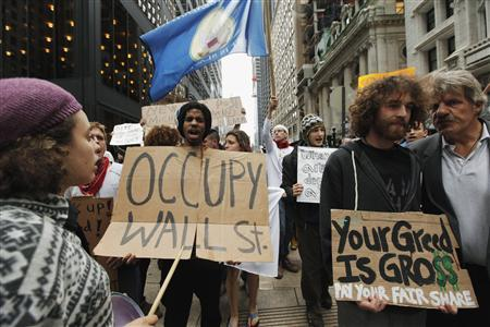 Members of the Occupy Wall Street movement take part in a protest march through New York